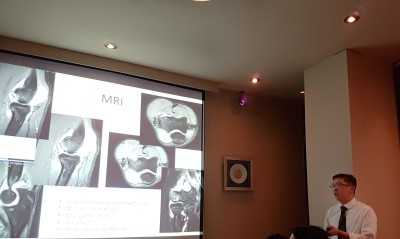 Dr Andy Wee speaking at symposium